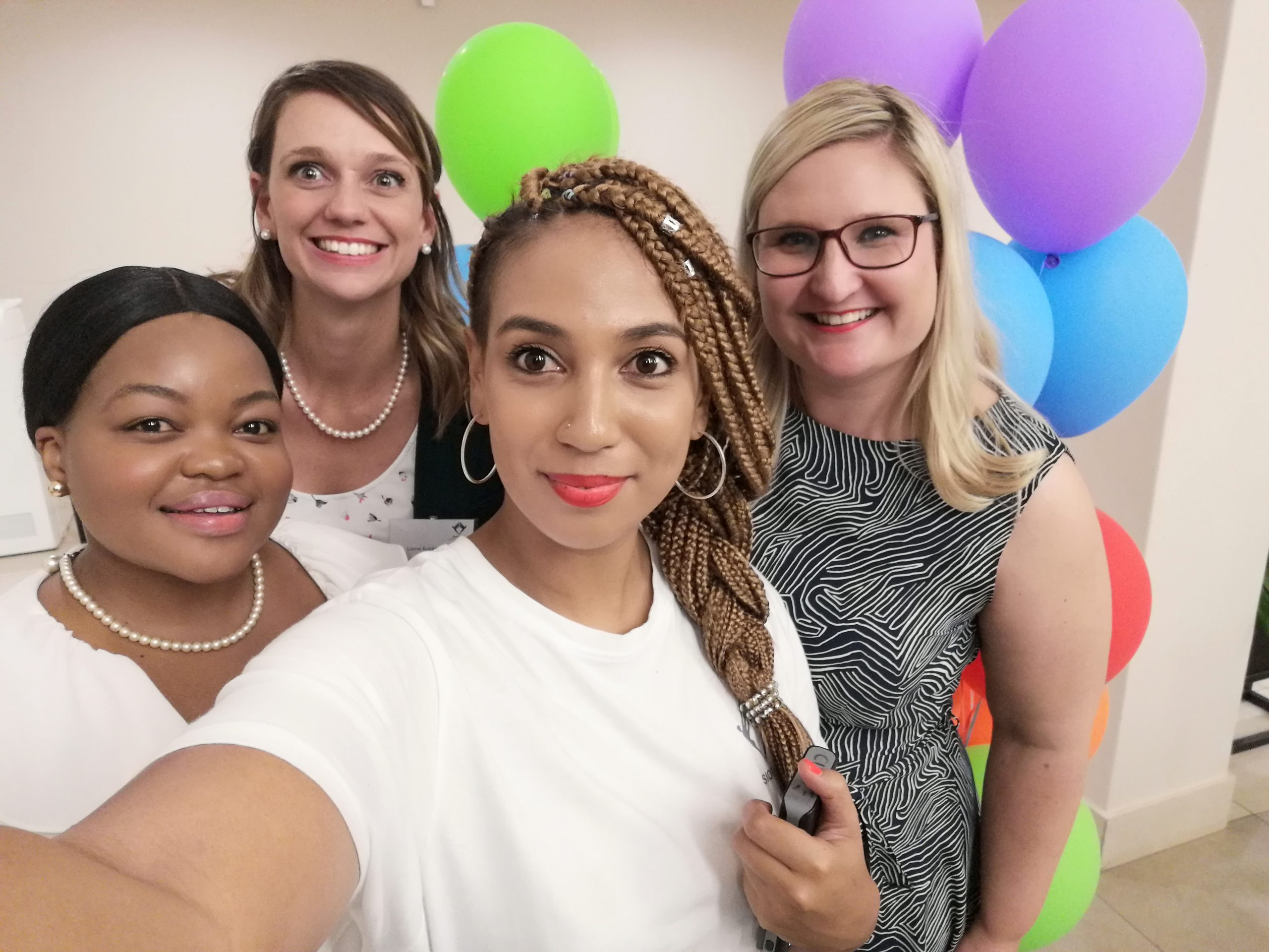 SIOPSA team with colourful balloons